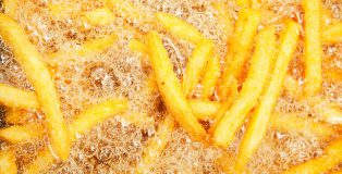 Fast Food French Fries in Restaurant Deep Fryer